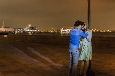 each other: Couple touching forehead each other at wharf