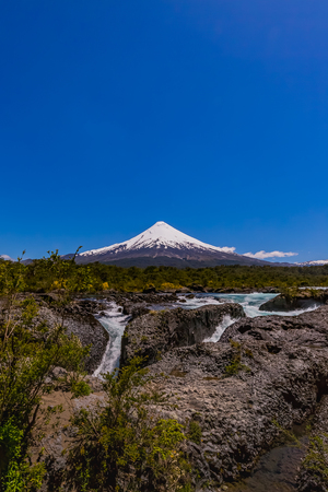 Osorno volcano and Petrohue waterfall in Chile 스톡 콘텐츠