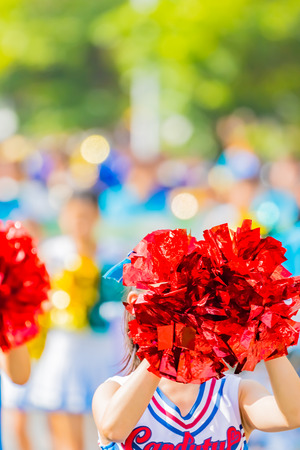 red cheerleader pom poms Stock Photo