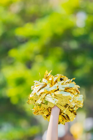 yellow cheerleader pom poms Stock Photo