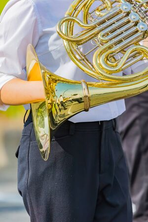 student playing french horn, music instrucment 写真素材 - 132119448
