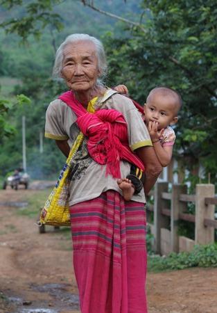 ka: BAAN TEE CHOR CHEE , MAE CHAN, Umphang,TAK, Thailand,, Photo taken July 4,2014,Grandmother and her nephew,Two Pa Ka Ka Yor in the mountain