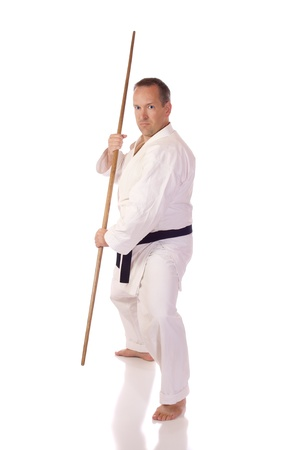 Man in karate-gi with a bo  staff  in his hands Stok Fotoğraf
