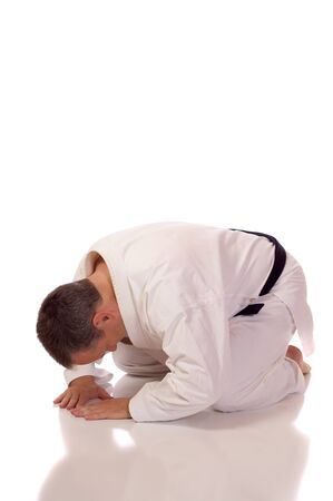 Man in karate-gi in the seiza position