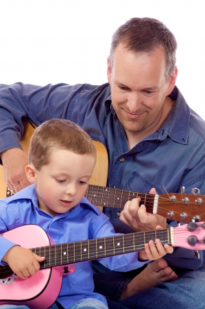 Father and son holding their guitar Stock Photo