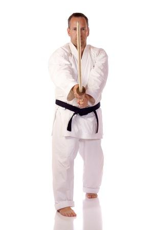 Man in karate-gi holding a boken Stock Photo