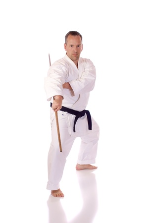 Man in karate-gi holding a bo staff