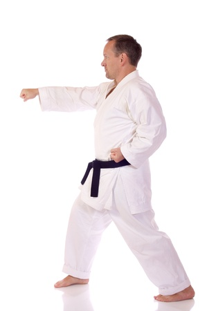 Man in karate-gi doing a punch photo
