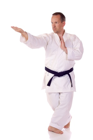 Man in traditional clothing doing karate photo