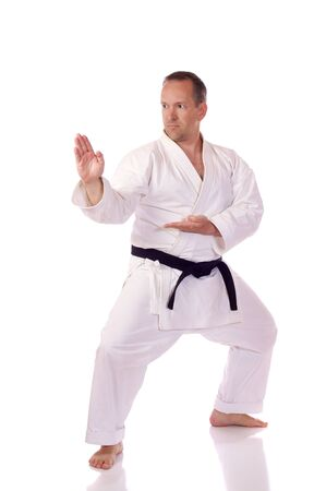 Man in traditional clothing doing karate