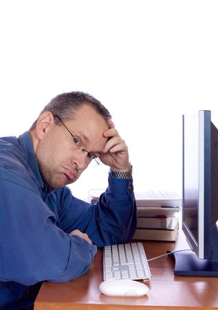 Tired man in front of his computer