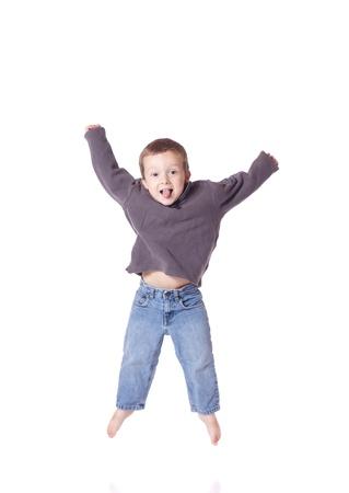 Cute little boy jumping up Stock Photo