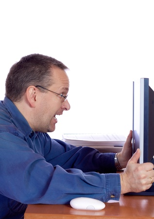 Surprised man in front of his computer