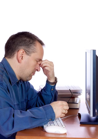 Tired man in front of his computer Stock Photo - 18542984