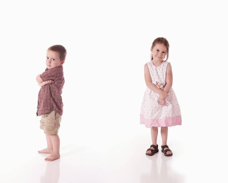 Sulky brother and smiling sister (white background)