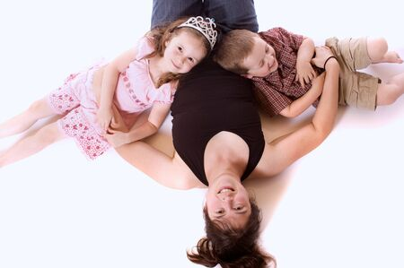 chuckle: Mother, daughter and son playing and laughing  white background