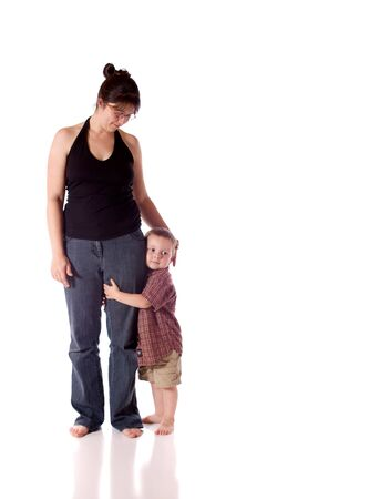 Mother and son standing close  white background