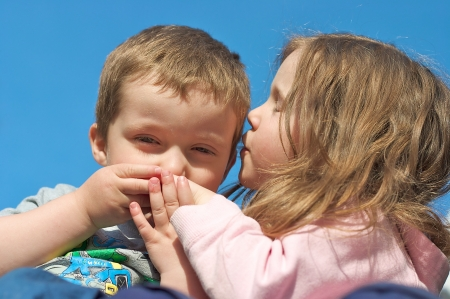 Brother and sister kissing photo