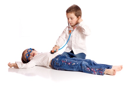doctor toys: Cute little brother and sister playing doctor