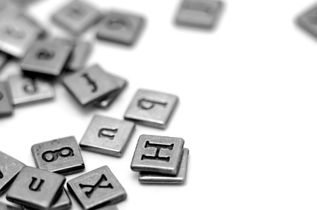 avocation: Metal scrapbooking letters laying on a white background.
