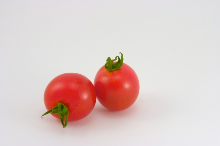 Cherry tomatoes on a white background Banco de Imagens