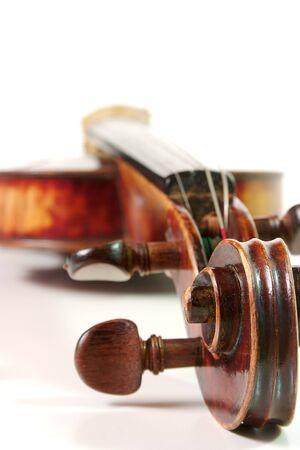 Antique violin on a white backgound Stock Photo