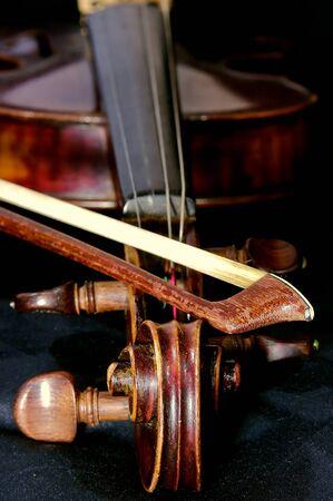 violins: Antique violin with some chalk on a black backgound