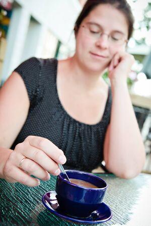 Woman having a coffee outside a restaurant photo