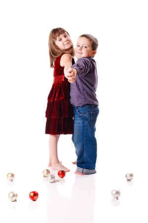 couple winter: Cute little boy and girl dancing Stock Photo