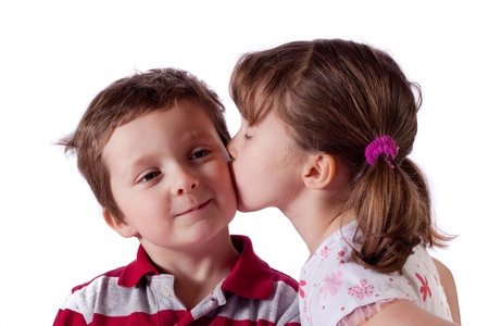 Cute little girl kissing a boy photo