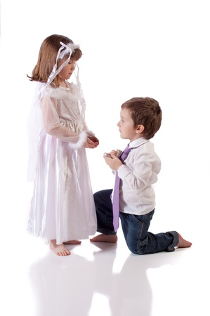 Cute little boy giving an engagement ring to a girl Stock Photo - 18576862