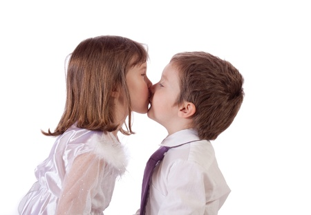 Cute little children kissing photo