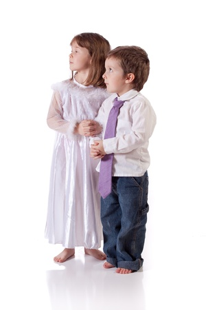 Cute little boy and girl wishing to get married
