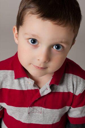 Cute little boy looking up Stock Photo