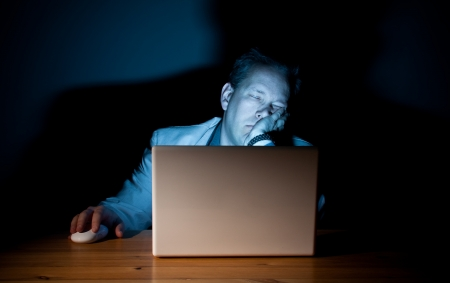 Man asleep in front of his computer Stok Fotoğraf