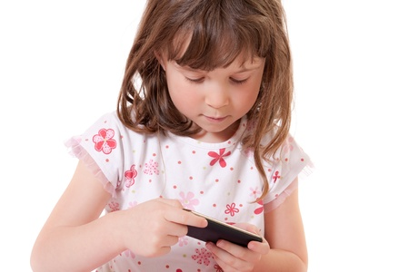 Cute little girl holding a portable video game photo