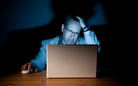 Man looking demoralized in front of his computer