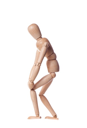 Wooden puppet with knee pain