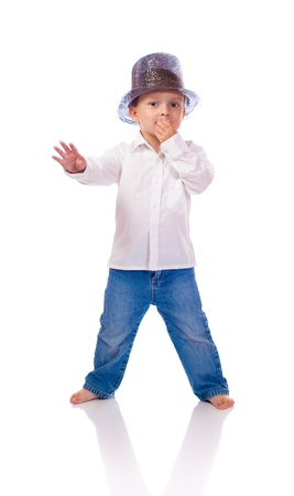 Little boy with a hat dancing photo