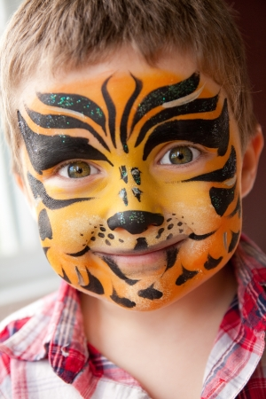 Cute little boy with a tiger make-up Stock Photo