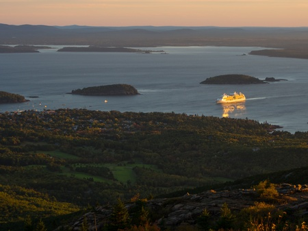 Cruise ship arriving at Bar Harbor at sunrise