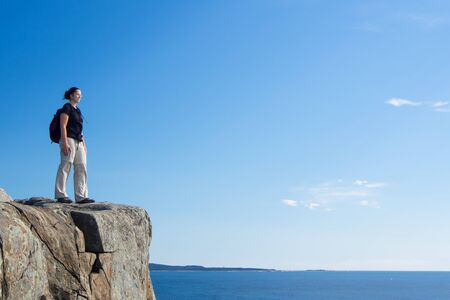 Woman hiking in Acadia National Park