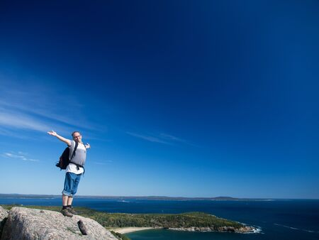 Man hiking in Acadia National Park photo