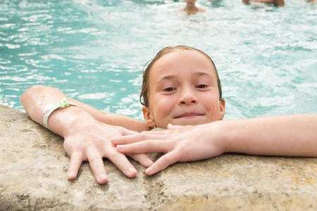 Smiling girl in a swimming pool photo