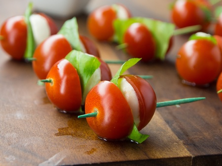 toothpick: tomato and cheese apetizer on a toothpick