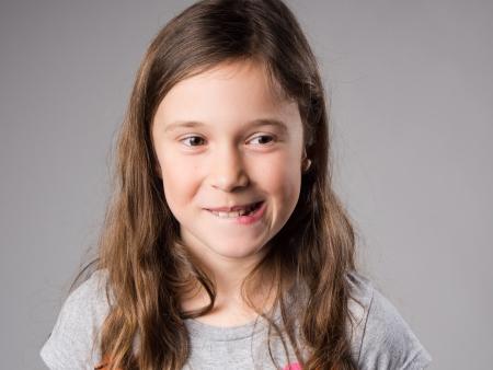 Mischievous little girl in studio Stock Photo
