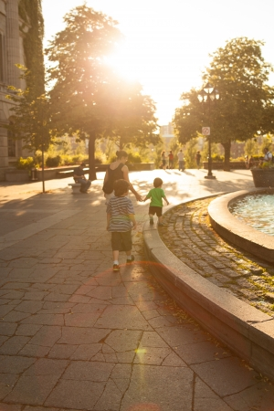 Family walking in downtown Montreal at sunset Stock Photo