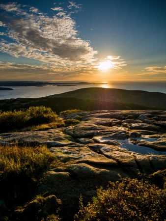 Sunrise over the sea on top of Cadillac Mountain in Acadia National Park