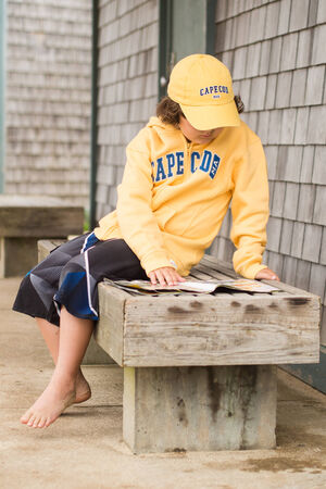 Boy reading outside in Cape Cod photo