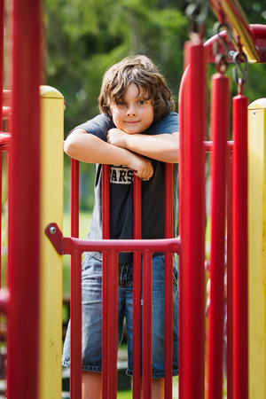Boy playing outside in a playground Stock Photo